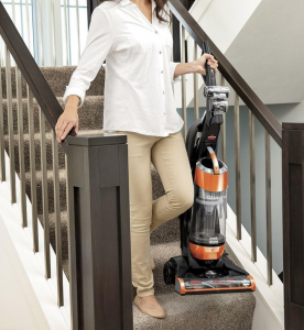 cleaning stairs with vacuum cleaner